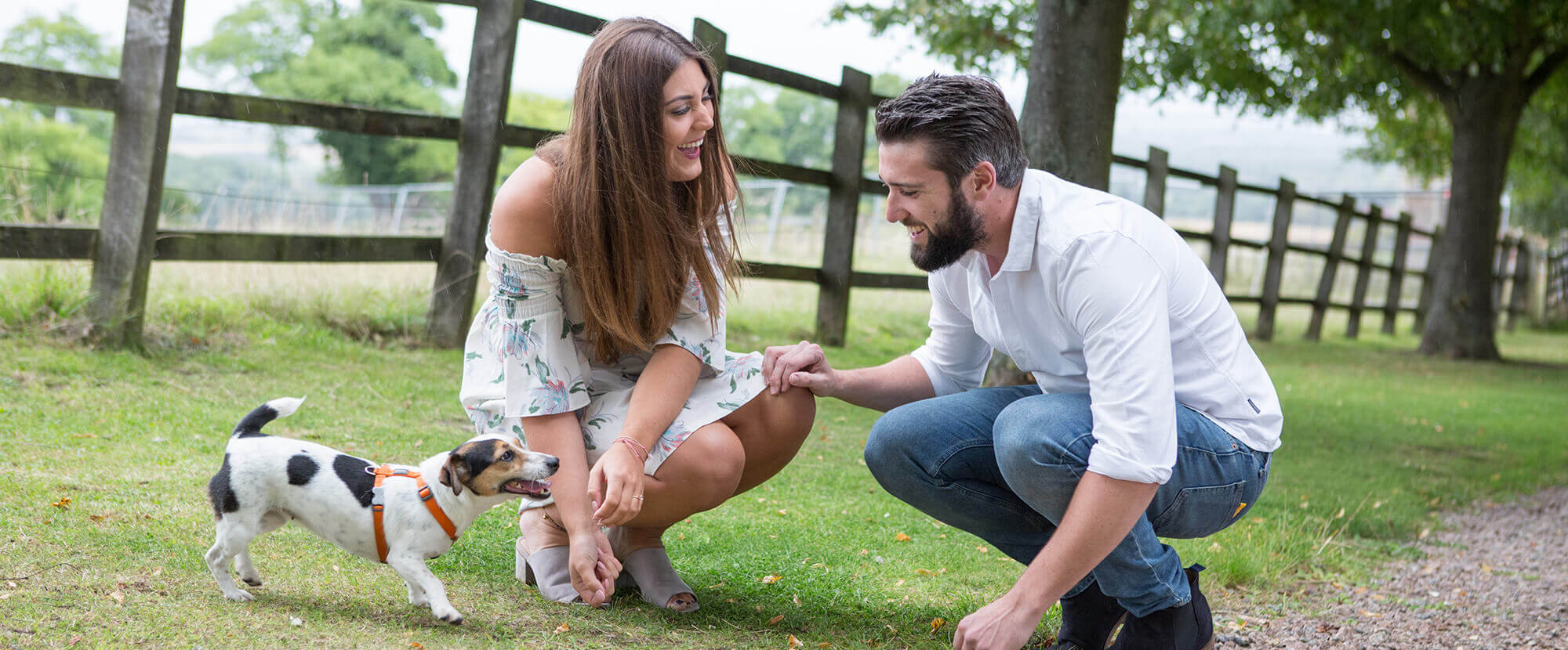 Happy couple with dog on engagement shoot