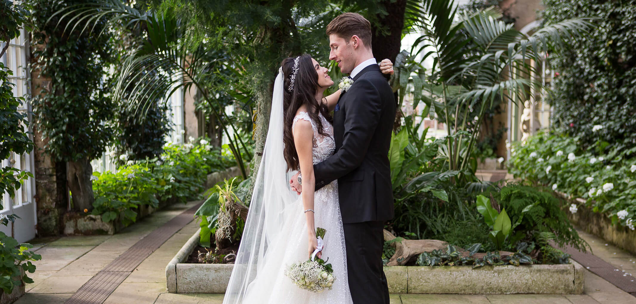 A newly married couple look at each other happily at a Hertfordshire venue