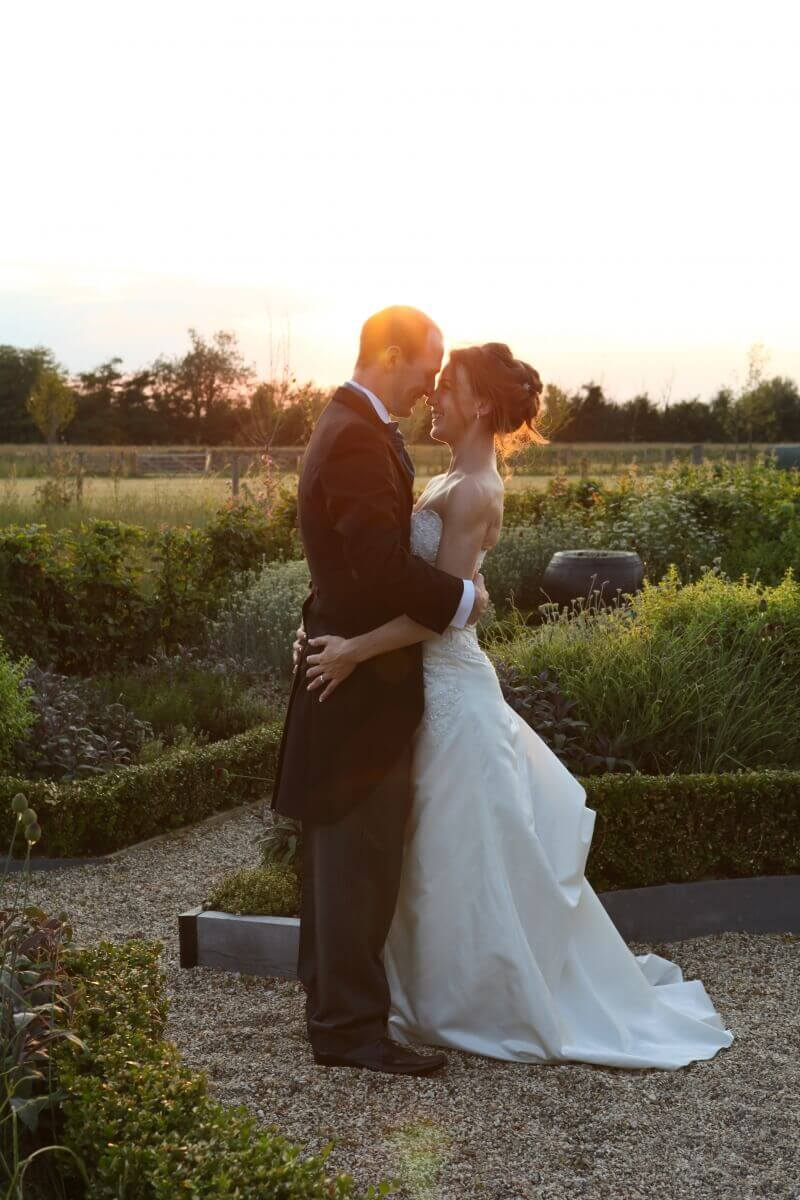 Sunset wedding photograph with the stunning bride and groom and South Farm wedding venue
