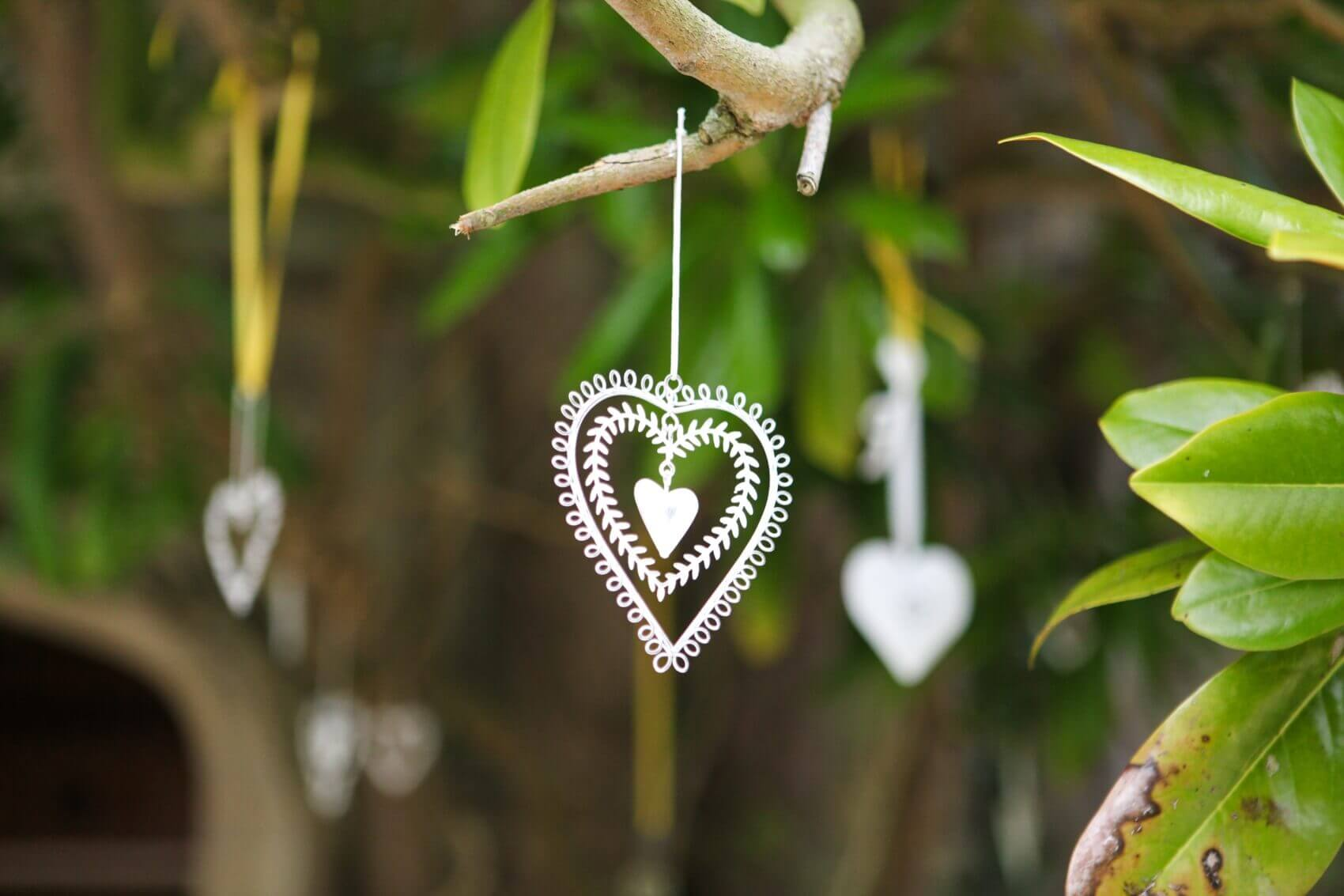 Delicate wedding decoration hanging from a tree at Tofte Manor Sharnbrook
