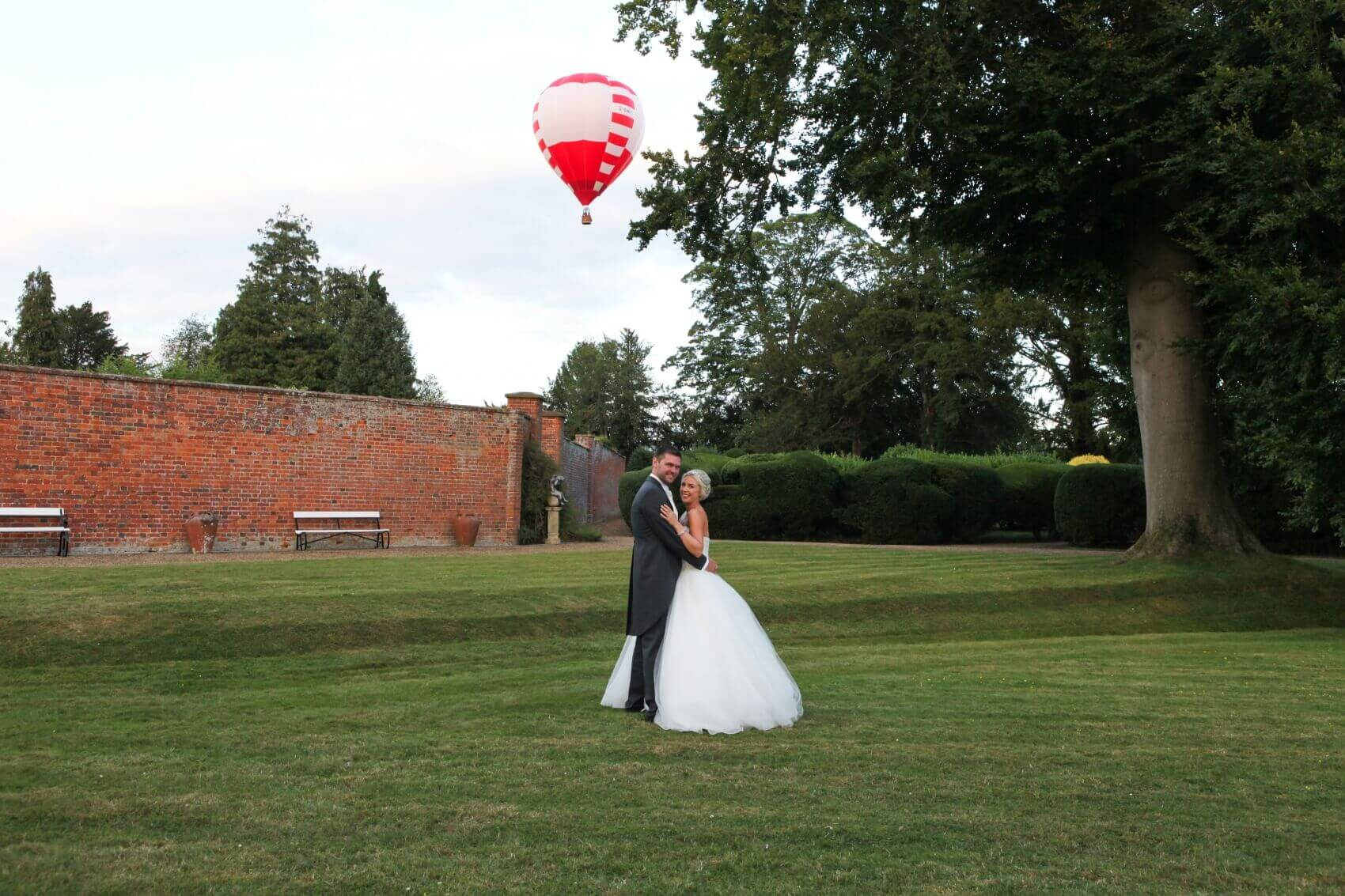 Bride and groom with a hot air ballon at Turvey House Bedfordshire