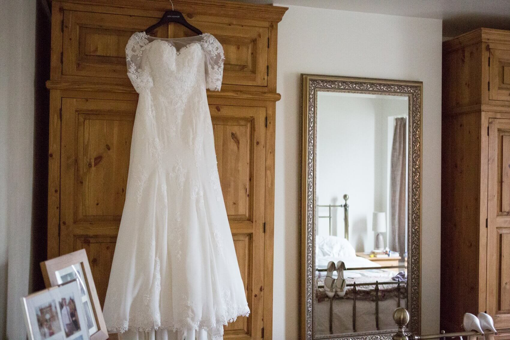 Wedding dress hanging up in the bedroom