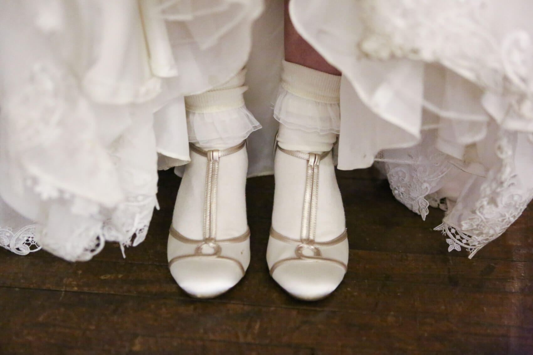 Bride's beautiful cream wedding shoes at Evershoult Hall