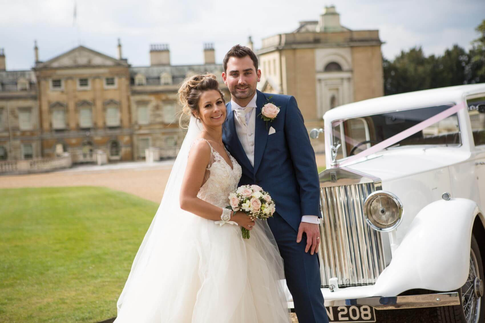 Bedfordshire wedding photographer at The sculpture Gallery in Woburn with the bride and groom and a white vintage wedding car