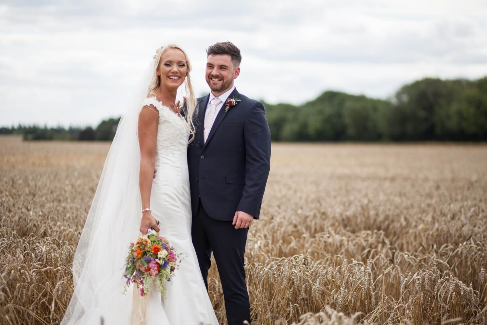 Bride and groom in the cornfields at Bassmead Mannor