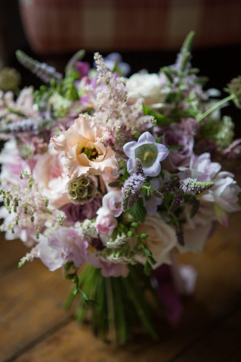 Flowers by Millie Richardson florist wedding bouquet of light colours on a wooden floor