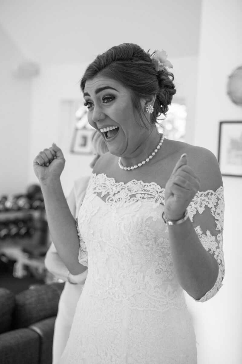 Black and white image of an excited bride